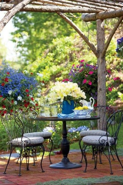 Sillas de jard n para terrazas r sticas forja hispalense for Sillas para terraza y jardin
